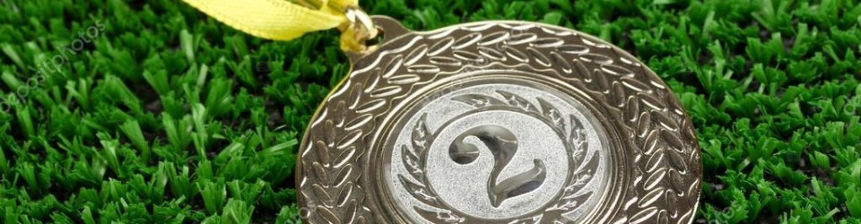 depositphotos_23190900-stock-photo-silver-medal-on-grass-background